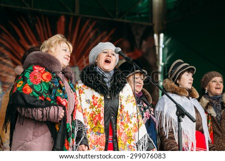 GOMEL, BELARUS - February 21, 2014: Unknown women group in national clothes at Celebration of Maslenitsa - traditional Russian holiday dedicated to approach of spring - Slavic celebration Shrovetide.