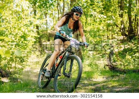 GOMEL, BELARUS - JUNE 7, 2015: Mountain bike cyclist riding track at sunny day in a forest - stock photo