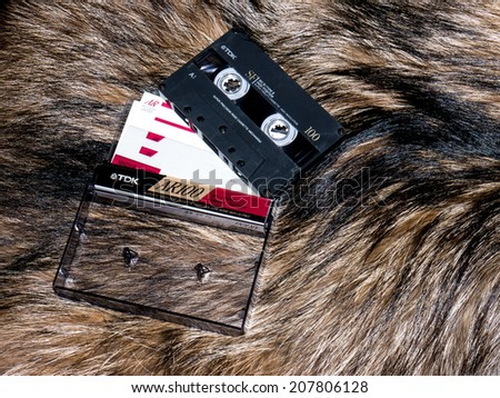 GOMEL, BELARUS - JUNE 11, 2014: TDK cassette tape  on fur background. TDK Corporation, is a Japanese multinational electronics company that manufactures electronic materials, and data-storage media. - stock photo