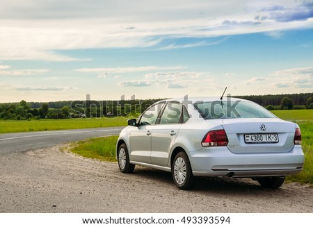 Gomel, Belarus - June 13, 2016: Volkswagen Polo car parked on the side of the road against the sky and the countryside