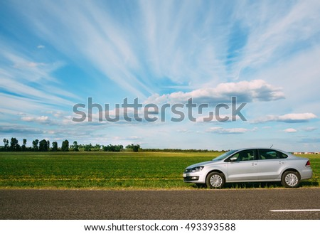 Gomel, Belarus - June 13, 2016: Volkswagen Polo standing on the side of the road on the background of the beautiful sky and green fields