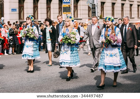 Gomel, Belarus - May 9, 2015: Woman in national Belarusian folk costume participating in the parade dedicated to the Victory Day - the 70th anniversary of the Victory in the Great Patriotic War