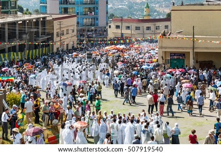 Gondar, Ethiopia - January 19 , 2016: A crowd of faithful and tourists surrounding a procession in the annual religious celebration of Timket (epiphany)