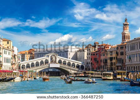 Gondola at the Rialto bridge in Venice, in a beautiful summer day in Italy  - stock photo