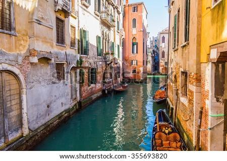 Gondola boat in beautiful canal, Venice, Italy - stock photo