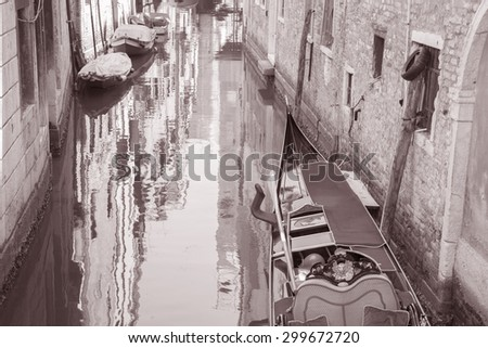 Gondola Boat in Canal, Venice, Italy in Black and White Sepia Tone - stock photo