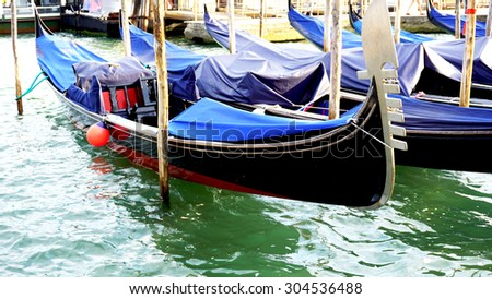 gondola boats floating in the water Venice, Italy