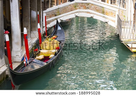 Gondola in a little canal in Venice.