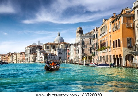 gondola in the canal of venice - stock photo