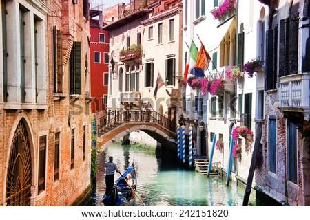 Gondola in the narrow streets of Venice, Italy - stock photo
