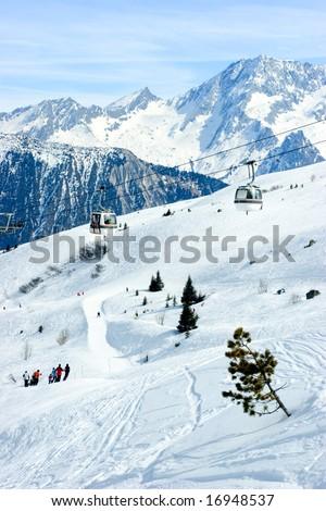 Gondola lift at  Courchevel ski resort, French Alps - stock photo