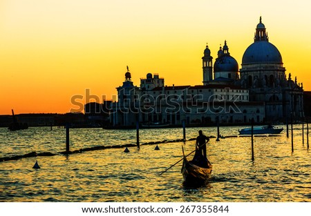 Gondola on Canal Grande with Basilica di Santa Maria della Salute in the background, Venice, Italy - stock photo