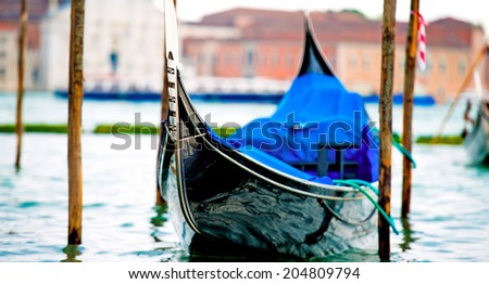 Gondola on the Grand Canal in Venice, Italy - stock photo