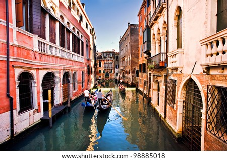 Gondola ride in small canal, Venice Italy - stock photo