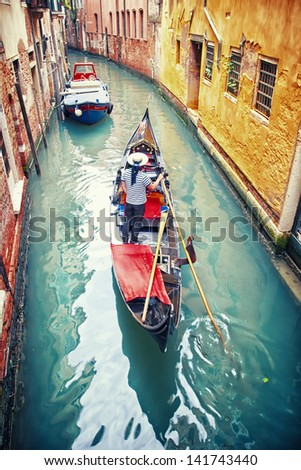 Gondola with gondolier in Venice, Italy - stock photo