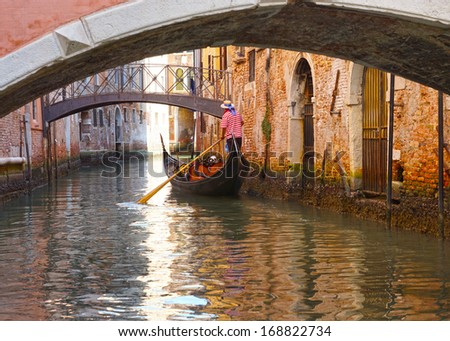 Gondolas and canals in Venice, Italy. - stock photo