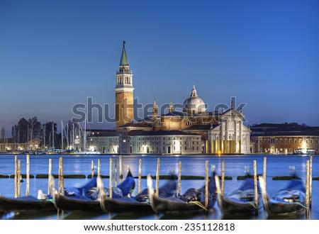 gondolas and San Giorgio di Maggiore churchin background at blue hour, Venice, Venezia, Italy, Europe. - stock photo