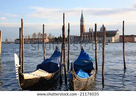 gondolas and Venice in background - stock photo