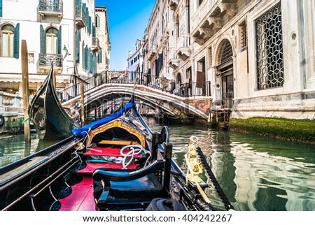 Gondolas are one of main attraction in lovely Venice. / Road with gondola is unique experience and great touristic attraction in Venice, Italy.