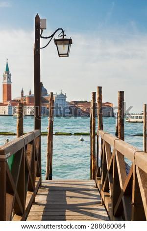 Gondolas embankment in the Grand Canal, Venice, Italy - stock photo