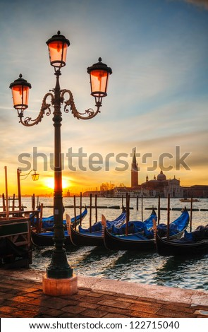 Gondolas floating in the Grand Canal on a cloudy day - stock photo