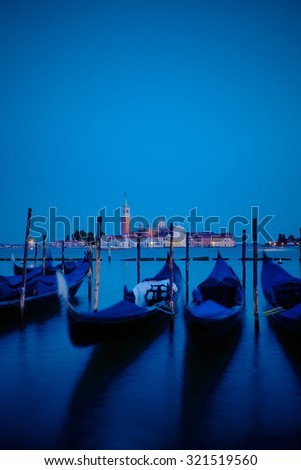 Gondolas floating in the Grand Canal, Venice, Italy - stock photo