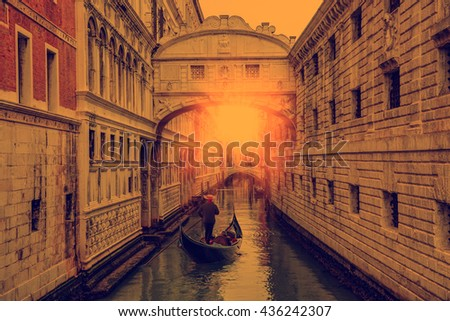 Gondolas floating on canal towards Bridge of Sighs (Ponte dei Sospiri). Venice, Italy