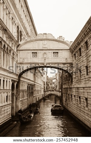 Gondolas floating on canal towards Bridge of Sighs (Ponte dei Sospiri). Venice, Italy. Perspective. Aged photo. Sepia. - stock photo