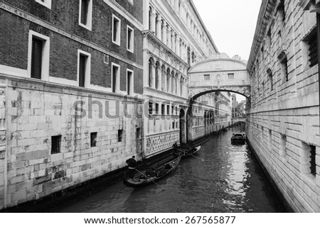 Gondolas floating on canal towards Bridge of Sighs (Ponte dei Sospiri). Venice, Italy. Perspective. Aged photo. Black and white.