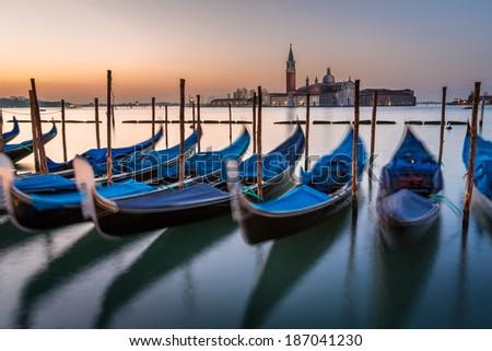 Gondolas, Grand Canal and San Giorgio Maggiore Church at Dawn, Venice, Italy - stock photo