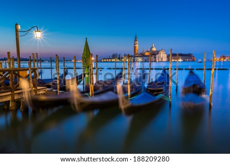 Gondolas, Grand Canal and San Giorgio Maggiore Church at Dawn, Venice, Italy - stock photo