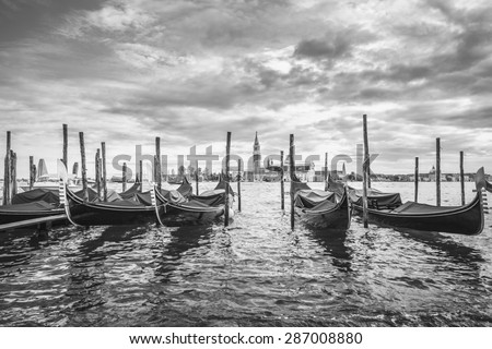 Gondolas in lagoon of Venice and San Giorgio island in background, Italy, Europe, black and white - stock photo