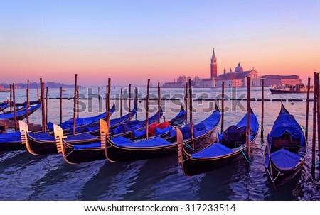 gondolas in Venice lagoon in high dynamic range effect - stock photo