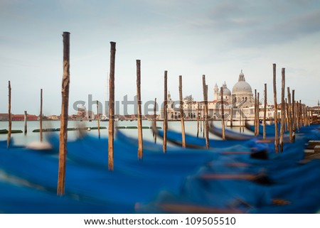 Gondolas in Venice with Santa Maria della Salute at sunrise, Venezia, Italy, Europe - stock photo