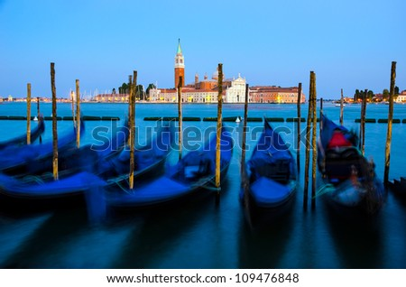 Gondolas moored at the Piazza San Marco with the Cathedral of San Giorgio Maggiore in the background, Venice, Italy - stock photo