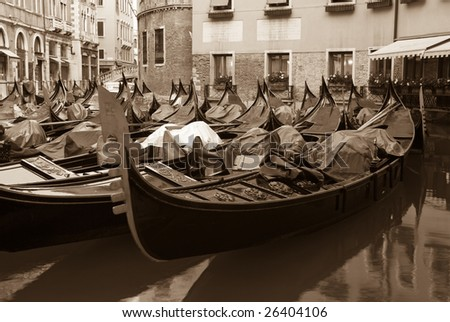 Gondolas moored behind the Piazza San Marco, Venice, Italy (sepia toned). - stock photo