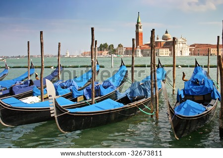 Gondolas moored by the Piazzetta di San Marco in Venice with the Isola di San Giorgio Maggiore across the canal in the background - stock photo