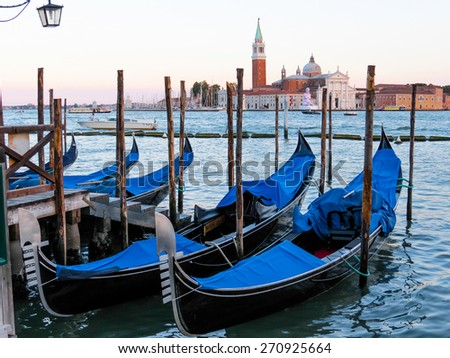 Gondolas moored in the water with a view of Santa Maria della Salute church, Venice, Italy