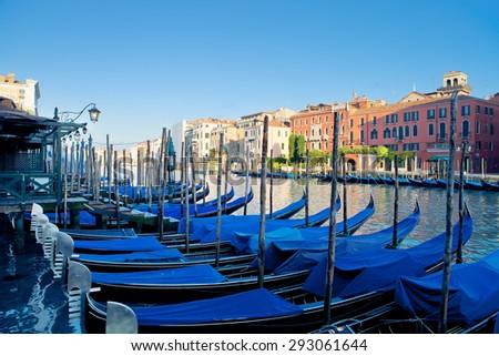 Gondolas moored near famous Rialto Bridge in Venice, Italy - stock photo