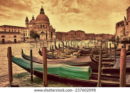 Gondolas moored on Grand Canal opposite Santa Maria della Salute church in Venice, Italy. Filtered image, vintage effect applied - stock photo