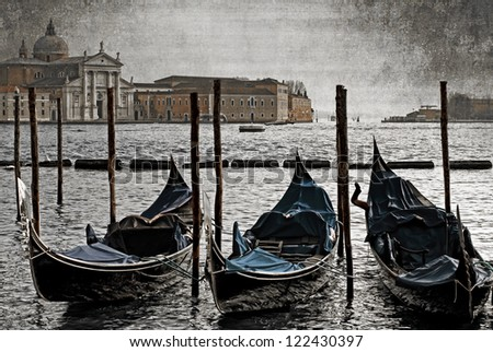 Gondolas moored on the Grand Canal, Venice, Italy