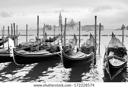Gondolas near Saint Mark square in Venice, Italy. Black and white image. - stock photo