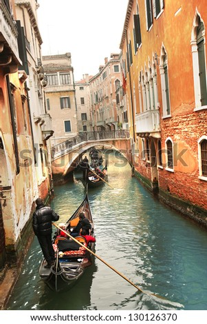 Gondolas on canal in Venice, Italy - stock photo