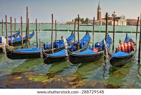 Gondolas on Grand Canal in front of San Giorgio Maggiore church in Venice.  - stock photo