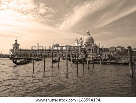 gondolas on the Grand Canal in Venice, sepia. - stock photo