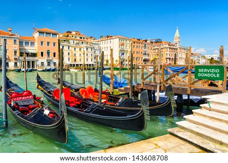 Gondolas on the Grand Canal in Venice with the Piazza San Marco in the background, Italy - stock photo