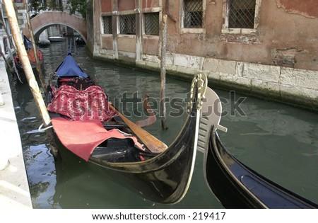 Gondolas on water in a narrow canal, Venice, Italy, - stock photo