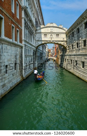 Gondolas passing over Bridge of Sighs - Ponte dei Sospiri - stock photo