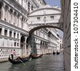 Gondolas passing over Bridge of Sighs - Ponte dei Sospiri. A legend says that lovers will be granted eternal love if they kiss on a gondola at sunset under the Bridge. Venice,Veneto, Italy, Europe. - stock photo