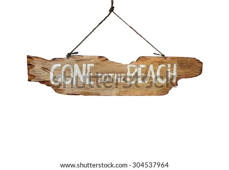Gone to the Beach hand carved sign - holiday vacation concept image. - stock photo